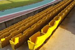 Empty orange stadium seat Stock Images
