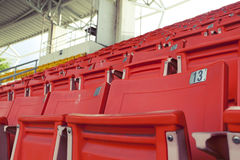 Empty orange stadium seat Royalty Free Stock Photos
