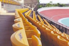 Empty orange stadium seat Royalty Free Stock Photo