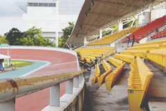 Empty orange stadium seat Royalty Free Stock Photos