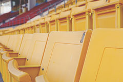 Empty orange stadium seat Stock Images