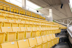 Empty orange stadium seat Stock Photography