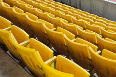 Empty orange stadium seat Royalty Free Stock Image