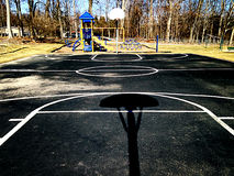 Empty outdoor basketball court Stock Images