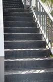 Empty outdoor black cement staircase Stock Image
