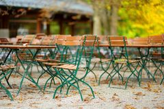 Empty outdoor cafe on beautiful autumn day in Munich, Germany. Stock Photo