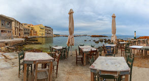 Empty outdoor cafe in the morning, Chania, Crete Royalty Free Stock Photo