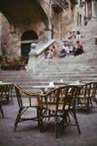 Empty outdoor cafe in old town. Street restaurant. Menu of Mediterranean tasty food Stock Photo