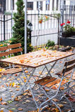 Empty outdoor cafe table on the rainy day Stock Photo
