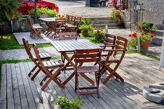 Empty outdoor cafe table. Empty outdoor cafe wooden table with chairs Royalty Free Stock Photography