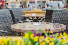 Empty outdoor cafe terrace on rainy day stock images