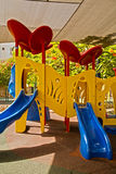 Empty outdoor colorful attractive playground Stock Photos