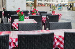 Empty outdoor family restaurant terrace on rainy day Royalty Free Stock Images