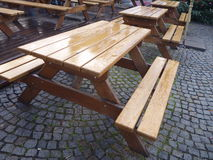 Empty outdoor fastfood tables with bench Stock Photos
