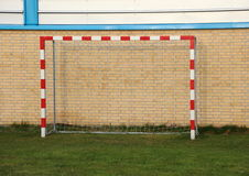 Empty outdoor handball goal with wall in background Royalty Free Stock Photos