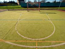 Empty outdoor handball playground, plastic hairy green surface on ground and white blue bounds lines. Empty outdoor hand ball playground, plastic hairy green Stock Image