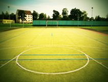 Empty outdoor handball playground, plastic light green surface on ground and white blue bounds lines. Royalty Free Stock Photography