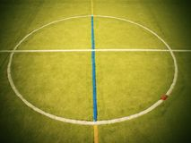Empty outdoor handball playground, plastic light green surface on ground and white blue bounds lines. Stock Photos