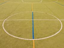 Empty outdoor handball playground, plastic light green surface on ground and white blue lines. Royalty Free Stock Photography