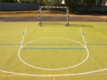 Empty outdoor handball playground, plastic light green surface on ground and white blue lines. Stock Image