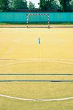 Empty outdoor handball playground, plastic light green surface Royalty Free Stock Photos