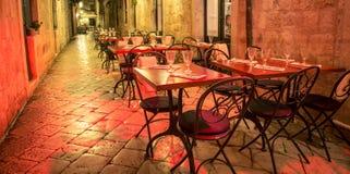 Empty outdoor restaurant Dubrovnik Royalty Free Stock Photos