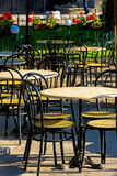 Empty outdoor restaurant seats Stock Photo