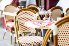 Empty outdoor restaurant table in Paris, France.  Royalty Free Stock Photo