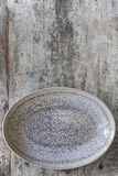 Empty Oval Dish over Rustic Timber Top View. Empty oval dish on rustic timber.  Top view.  Food background Stock Photo