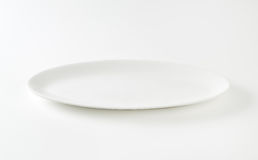 Empty oval white plate Royalty Free Stock Photography