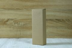 Empty Package brown cardboard box or tray on bright wooden table Royalty Free Stock Photography