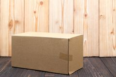 Empty Package brown cardboard box or tray on wooden background, mock up royalty free stock photography