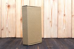Empty Package brown cardboard box or tray on wooden background, mock up stock image