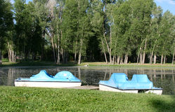 Empty paddle boats. Two empty paddle ponds in a pond royalty free stock photo