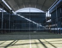 Empty paddle tennis court in sunny day. Wide angle image of empty paddle tennis court stock photos