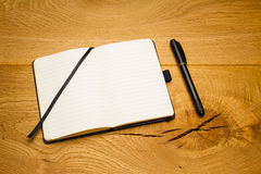 Empty pages notebook marker skew on desk Royalty Free Stock Image