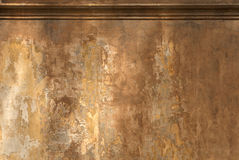 Empty painted wall. Empty wall painted with many layers of fading warm tones Stock Image
