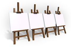 Empty Painting Easels. Four Empty Painting Easels  on White Royalty Free Stock Photo