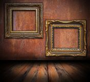 Empty painting frames on rusted wall. Interior architectural backdrop for your design Stock Images