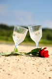 Empty pair glass on sand beach Royalty Free Stock Photography