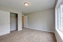 Empty pale grey room interior with a closet. Empty pale grey room interior with carpet floor and a closet. Northwest, USA stock photos