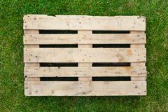 Empty pallet on green grass Stock Image