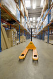 Empty pallet truck in warehouse Royalty Free Stock Image