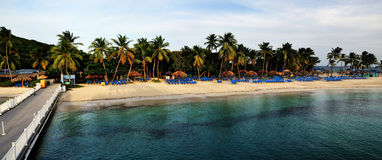 Empty Palomino beach in the evening. The white sand beach of Palomino empties out during the evening as vacationers return to the main island in Puerto Rico Royalty Free Stock Photos