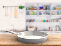 Empty pan with kitchen background Royalty Free Stock Photo