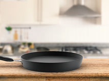 Empty pan with kitchen background Royalty Free Stock Photos