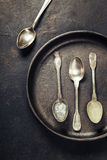 Empty pan with old spoons Stock Photography