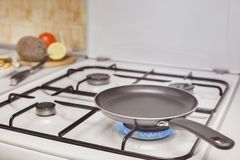 Empty pan on the stove Royalty Free Stock Images