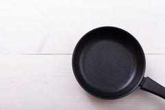 Empty pan on wooden deck table with tablecloth Stock Image