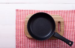 Empty pan on wooden deck table with tablecloth Royalty Free Stock Photography